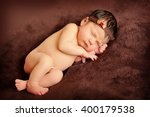 newborn baby girl on brown... | Shutterstock . vector #400179538