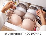 Stock photo woman choosing bra romantic lingerie drawers filled with sexy lace lingerie textile underwear 400197442