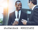 coffee break. two cheerful... | Shutterstock . vector #400221652