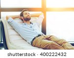 time to relax. handsome young... | Shutterstock . vector #400222432