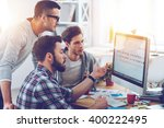 discussing new project. three... | Shutterstock . vector #400222495