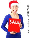 Excited christmas woman with santa hat holding red sale sign. Isolated on white background. - stock photo