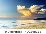 sunset on a sea beach with... | Shutterstock . vector #400248118