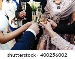 hands of happy people toasting... | Shutterstock . vector #400256002