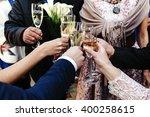 hands of happy people toasting... | Shutterstock . vector #400258615
