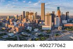 Small photo of Aerial panorama view of downtown Houston, Texas as seen from the near northeast side. New construction in this growing portion of the city is illuminated in early morning sunlight.