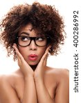 Small photo of Portrait of young beautiful african american girl with afro. Girl wearing eyeglasses. Closeup photo. Studio shot.