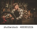 stylish bicycle mechanic doing... | Shutterstock . vector #400301026