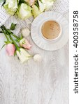 a cup of coffee with roses on... | Shutterstock . vector #400358758