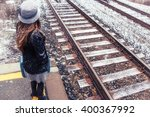 Woman And Winter Train Tracks....