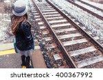 Woman And Winter Train Tracks....
