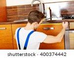 young repair man measuring... | Shutterstock . vector #400374442