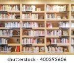 blurred bookshelf in library... | Shutterstock . vector #400393606