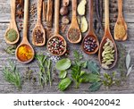 herbs and spices on a wooden... | Shutterstock . vector #400420042