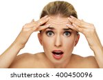 a young woman checking wrinkles ... | Shutterstock . vector #400450096