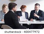 handsome businessman joking... | Shutterstock . vector #400477972