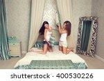 Two Girl Friends Having Pillow...