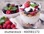 yogurt with muesli and berries... | Shutterstock . vector #400581172