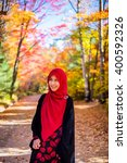 muslim woman with colourful... | Shutterstock . vector #400592326