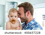 close up of happy father with... | Shutterstock . vector #400657228