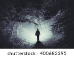 surreal light in dark forest... | Shutterstock . vector #400682395