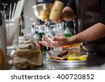 bartender pours alcoholic drink ... | Shutterstock . vector #400720852