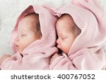newborn twins sisters sleeping... | Shutterstock . vector #400767052