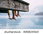father and son swung their legs ... | Shutterstock . vector #400824565