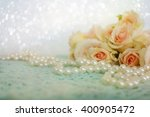 fresh roses flowers with pearls | Shutterstock . vector #400905472