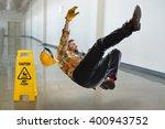 worker falling on wet floor... | Shutterstock . vector #400943752