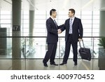 two businessmen  one asian and... | Shutterstock . vector #400970452