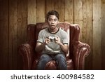 portrait of asian man playing... | Shutterstock . vector #400984582