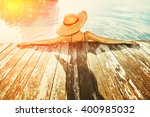 woman in hat relaxing at the... | Shutterstock . vector #400985032