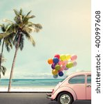Stock photo vintage card of car with colorful balloon on beach blue sky concept of love in summer and wedding 400997608