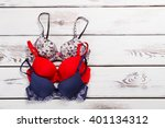 three different bra on a wooden ... | Shutterstock . vector #401134312