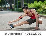 asian young jogger stretching... | Shutterstock . vector #401212702