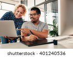 two young graphic designers... | Shutterstock . vector #401240536