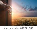 Hand Opens The Door To The...