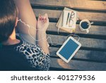 young woman sitting on wood... | Shutterstock . vector #401279536