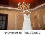 wedding dress on the rack | Shutterstock . vector #401362012