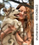 beautiful woman with young dog... | Shutterstock . vector #401428612