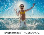 happy child playing in the sea. ... | Shutterstock . vector #401509972