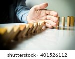 Businessman Hand Stop Dominoes...
