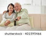 smiling senior couple watching... | Shutterstock . vector #401595466