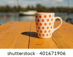 orange white cup on the wooden... | Shutterstock . vector #401671906