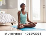 young black woman doing yoga at ... | Shutterstock . vector #401693095