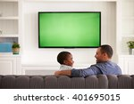 father and son watching tv... | Shutterstock . vector #401695015