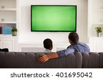 father and son watching tv at... | Shutterstock . vector #401695042