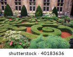 Formal gardens in a courtyard in Paris - stock photo