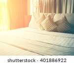 Stock photo vintage bed sheets and pillow messed up in the morning and color tone effect 401886922